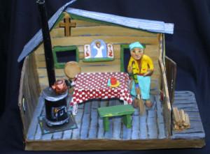 "With broom ""Grandma's House""c. 2002 by Hope Atkinson papier mache, cardboard, wood & found objects 9.75"" x 13.75 ""x 7"" $900 #4930"