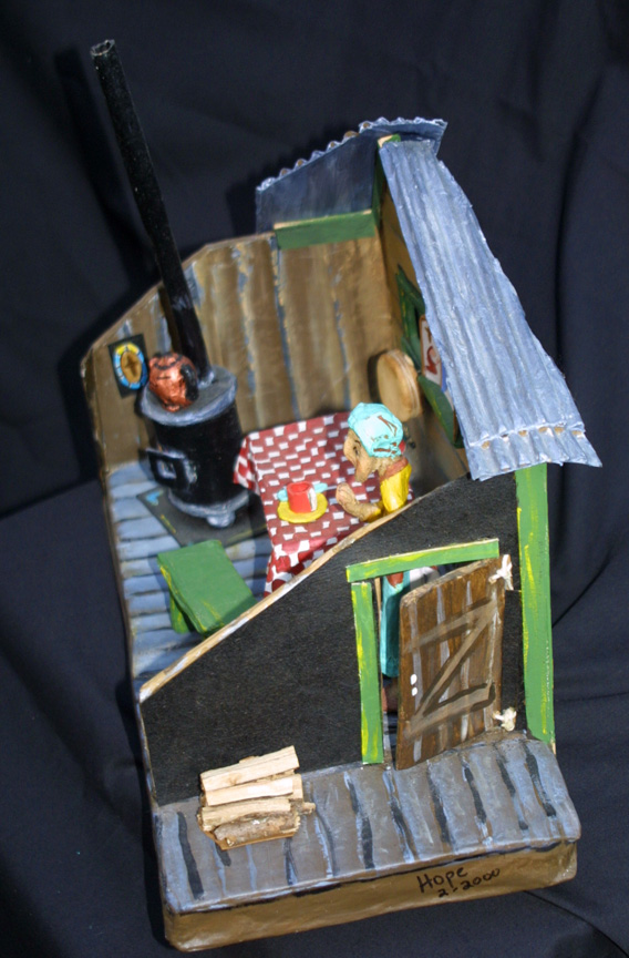 "side ""Grandma's House""c. 2002 by Hope Atkinson papier mache, cardboard, wood & found objects 9.75"" x 13.75 ""x 7"" $900 #4930"