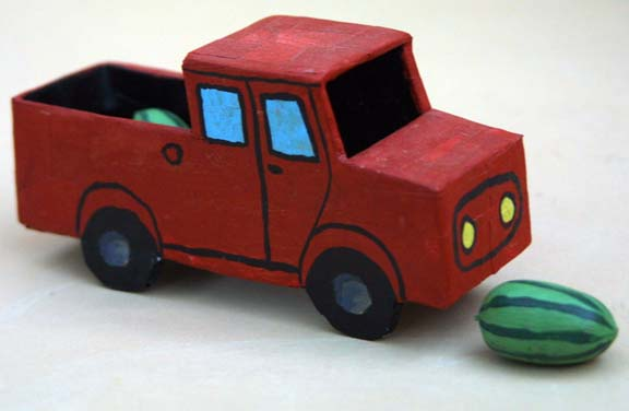 """Watermelon Truck"" by Chuck Crosby acrylic on shaped cardboard with pecans  2.3"" x 5.25"" x 1.5""  $200  #9197"