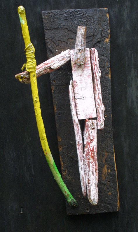 """Leader"" with staff  by Michael Banks  found wood, acrylic paint  aprox 32"" x 12""  $600  #11585"