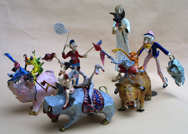 """A Toyful Story of Our Times"" 2011 by Hope Atkinson (3 figures and 3 piggy banks ridden by demons) tallest figure 12"" mixed media, acrylic on papier mache $5000 #10424"