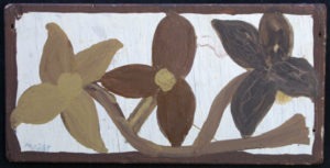 """Brown Flowers"" c. 1976   signed LL in ball point pen  by Mose Tolliver  oil paint on plywood - floss hanger  5.5"" x 11""  $800  #11885"