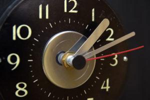 """Stud"" Wall Clock  by Jason Burnett  wood, found objects: salvaged window retractors, trophy parts, Studebaker emblem  15.25"" x 5.75"" x 3""   $300  #12088"