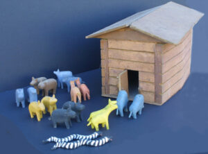 """Noah's Ark"" c. 1988 by Fred Webster (Ark with Noah, wife & 2 birds inside) with 9 pair of animals, unsigned carved, painted wood Ark: 8.75"" x 16.25"" x 8.75"" animals each:2"" x 2"" $2400 #12871"