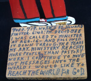 """Self Portrait dated Dec 12, 1988  by Howard Finster  painted wooden cutout on stand  11"""" x  6"""" x 4""""  $1600   #13054"""