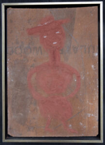"""""""Dancing Girl with Hat""""  c. 1989  by Jimmie Lee Sudduth  17.5"""" x 12.5""""  mud, kaolin, paint on wood  in black and silver floater frame  $1000  #13065"""